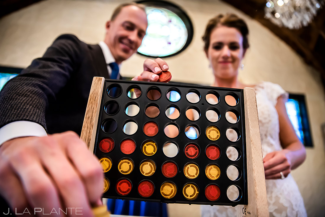 Bride and Groom Playing Connect 4 | Lionsgate Wedding | Boulder Wedding Photographer | J. La Plante Photo