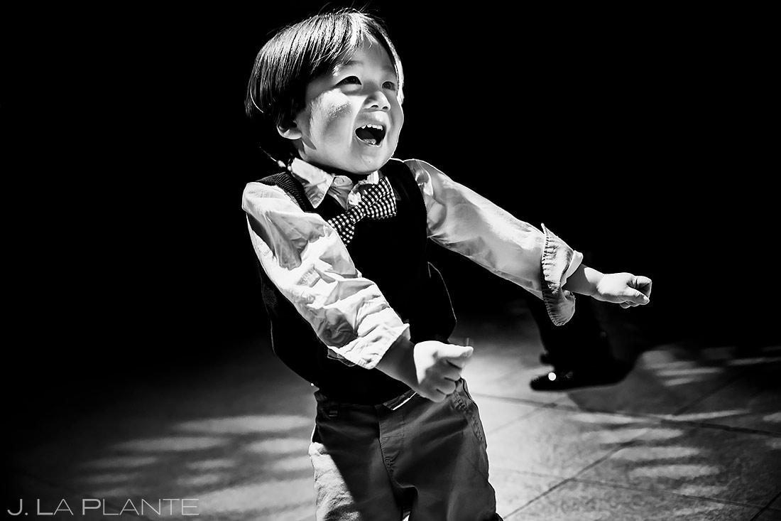 cute ring bearer dancing during wedding reception