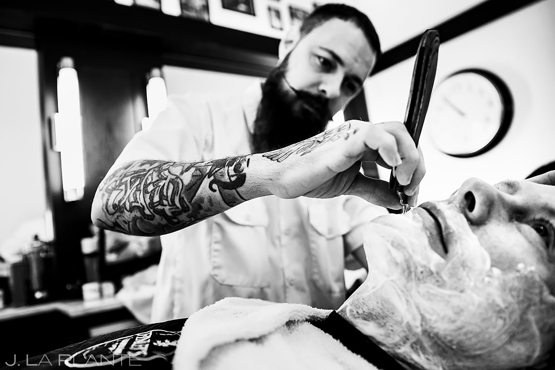 Groom getting a shave | Downtown Denver Wedding | Denver Wedding Photographer | J. La Plante Photo