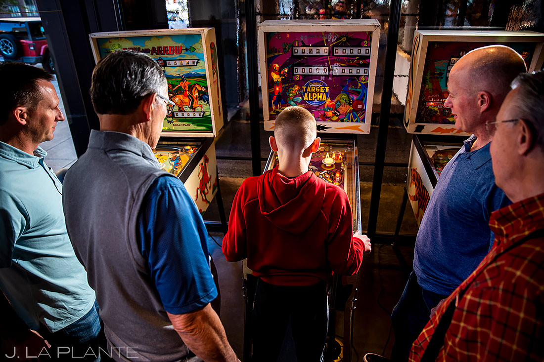 Groomsmen playing pinball | Downtown Denver Wedding | Denver Wedding Photographer | J. La Plante Photo