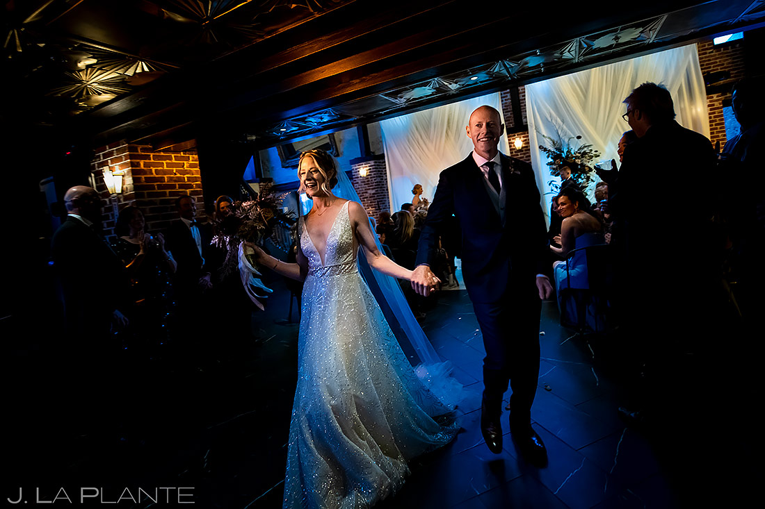 Bride and groom exiting ceremony | Ironworks Wedding | Denver Wedding Photographer | J. La Plante Photo