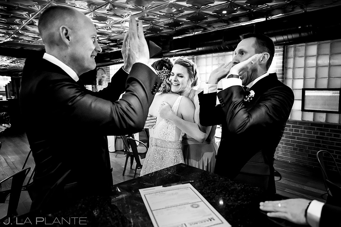 Groom high fiving best man | Ironworks Wedding | Denver Wedding Photographer | J. La Plante Photo