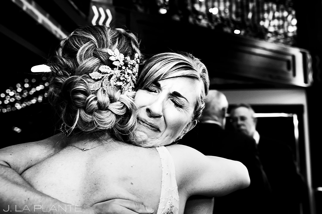 Bride hugging wedding guests | Ironworks Wedding | Denver Wedding Photographer | J. La Plante Photo
