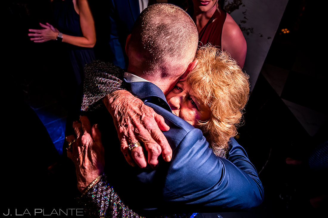 Bride's mother hugging groom | Ironworks Wedding | Denver Wedding Photographer | J. La Plante Photo