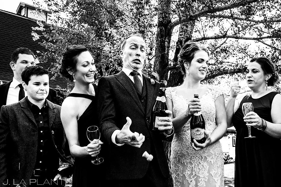 Wedding Party Popping Champagne   Lionsgate Wedding   Boulder Wedding Photographer   J. La Plante Photo