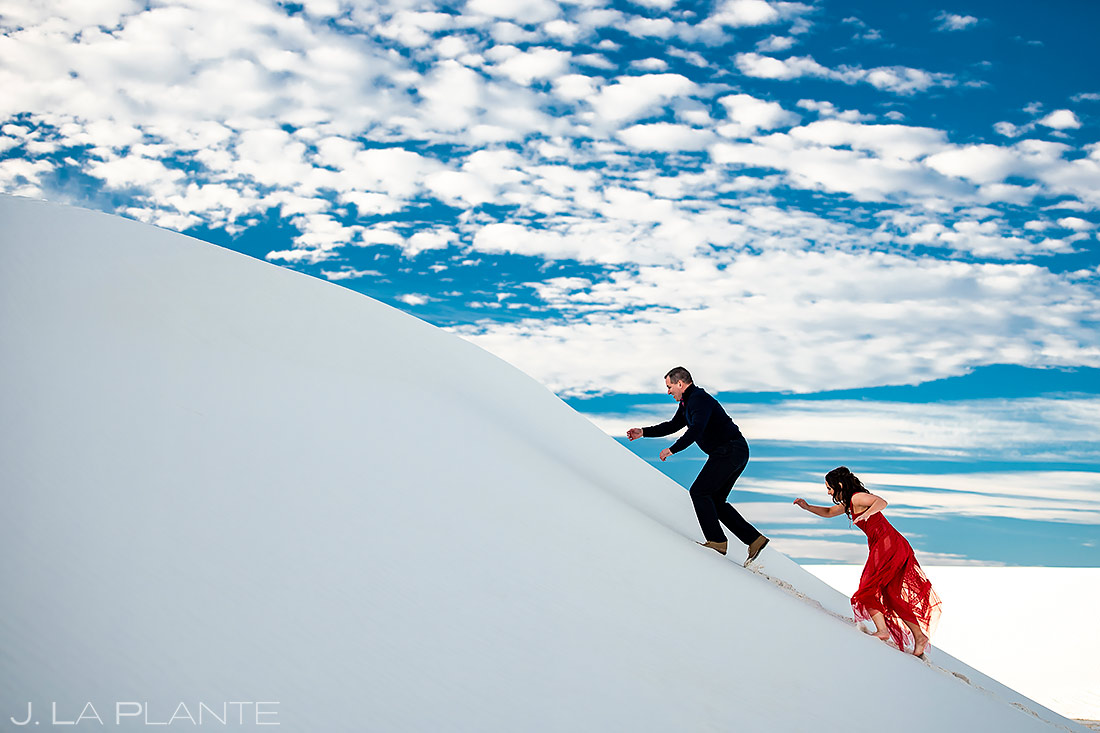 Bride and Groom Climbing Sand Dunes | White Sands Engagement | Destination Wedding Photographer | J. La Plante Photo