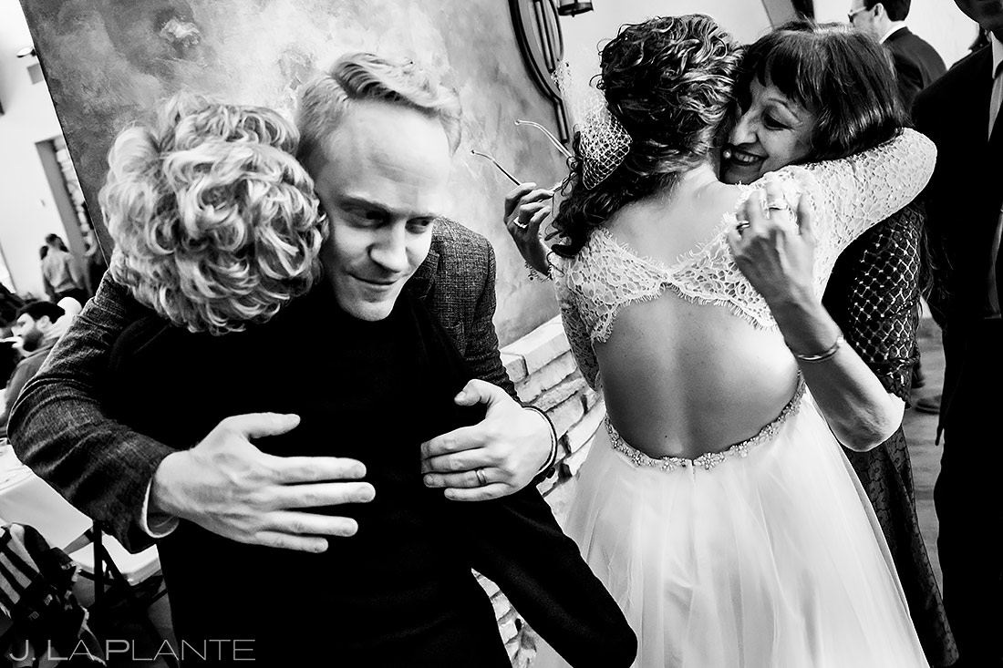 Bride and Groom Hugging Wedding Guests | Lodge at Cathedral Pines Wedding | Colorado Springs Wedding Photographer | J. La Plante Photo