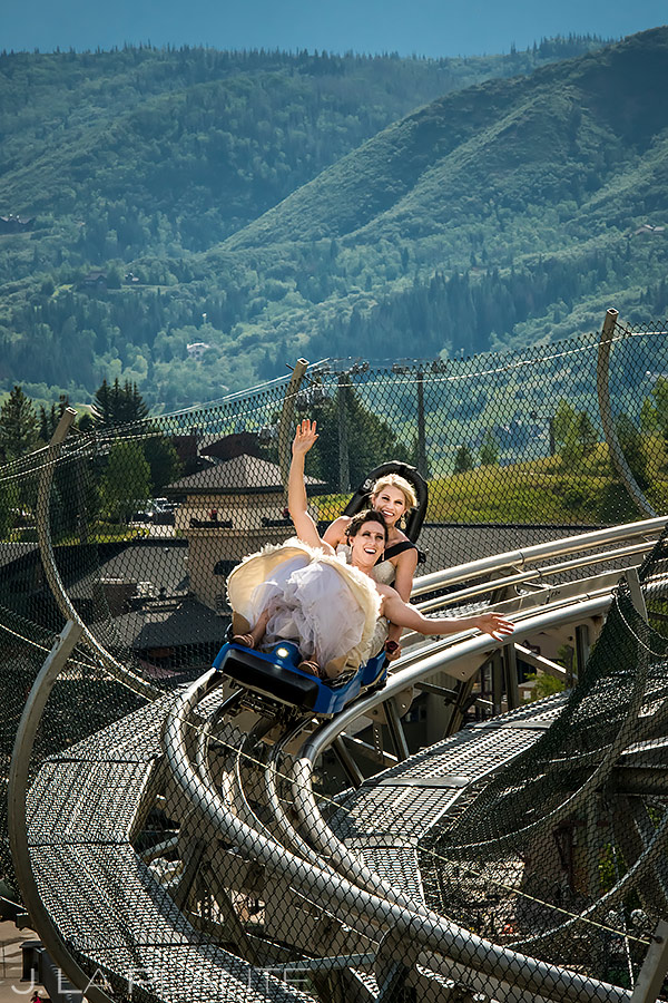 Bride and Bride Riding Roller Coaster | Thunderhead Lodge Wedding | Steamboat Springs Wedding Photographer | J. La Plante Photo