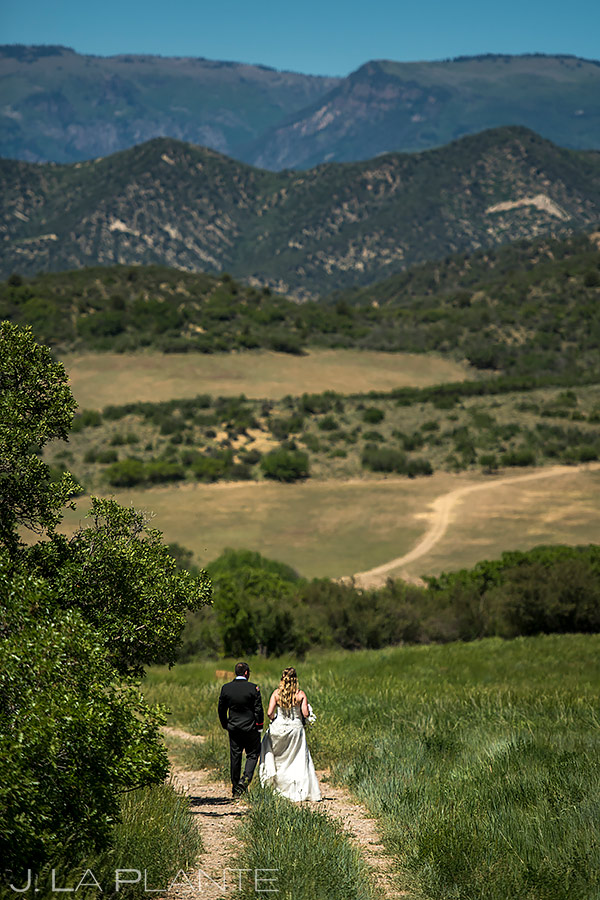 Bride and Groom Hiking | White Owl Ranch Wedding | Colorado Wedding Photographer | J. La Plante Photo