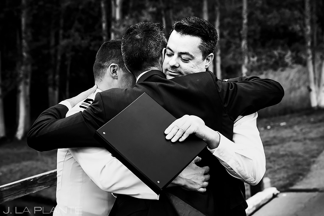 Grooms Hugging Wedding Officiant | Aspen Meadows Resort Wedding | Aspen Wedding Photographer | J. La Plante Photo