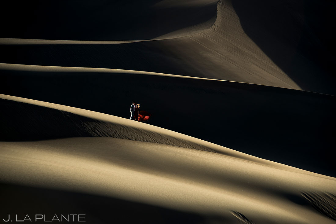 great sand dunes elopement bride and groom on sand dune