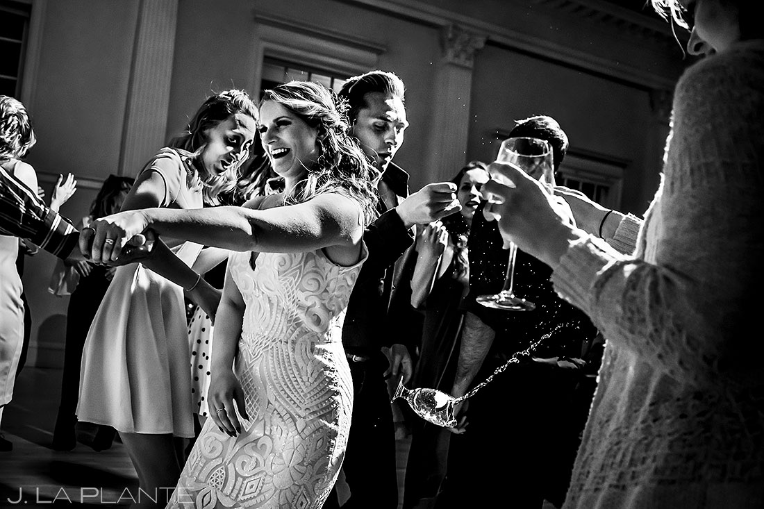 Stanley Hotel wedding guest dropping glass on the dance floor