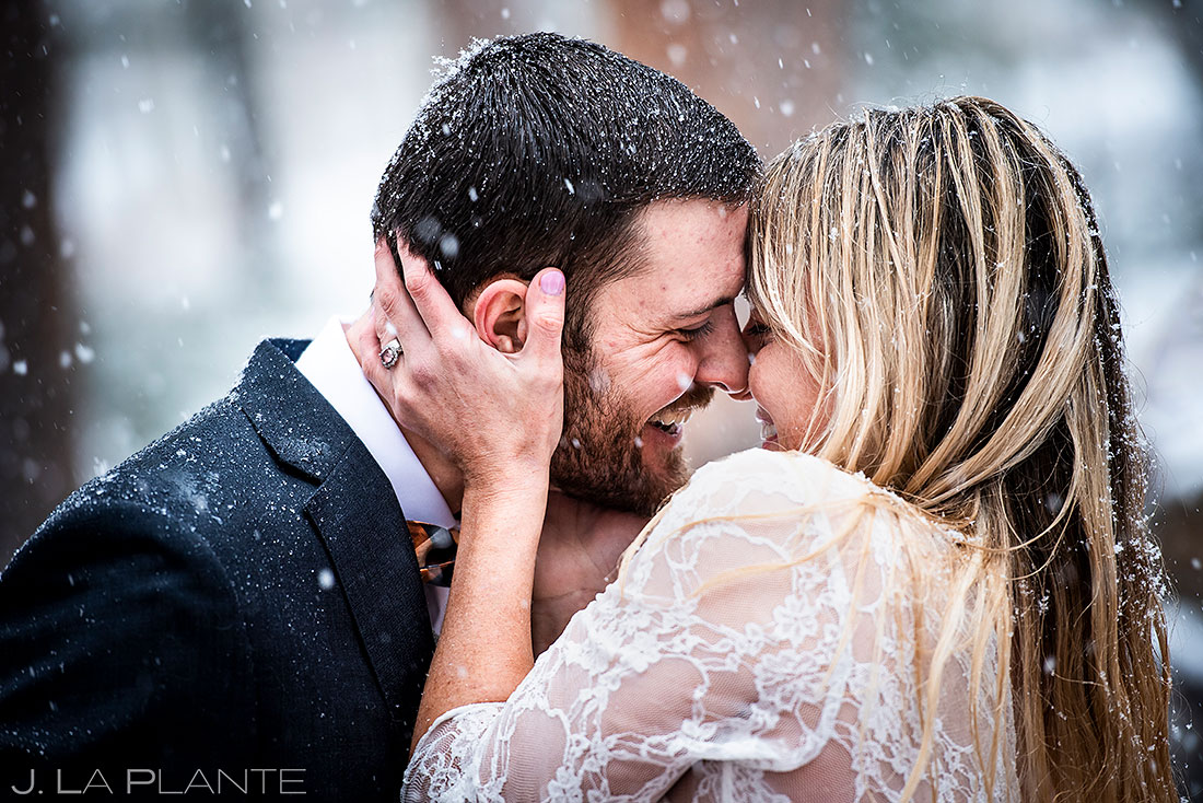 Sunshine Mountain Lodge wedding bride and groom first kiss