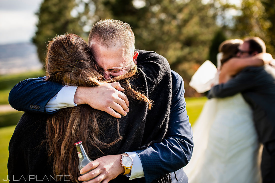 sanctuary golf course wedding groom hugging wedding guest