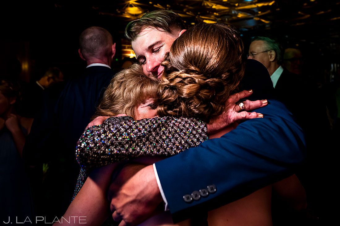 Ironworks Denver wedding bridesmaid hugging mother of the bride