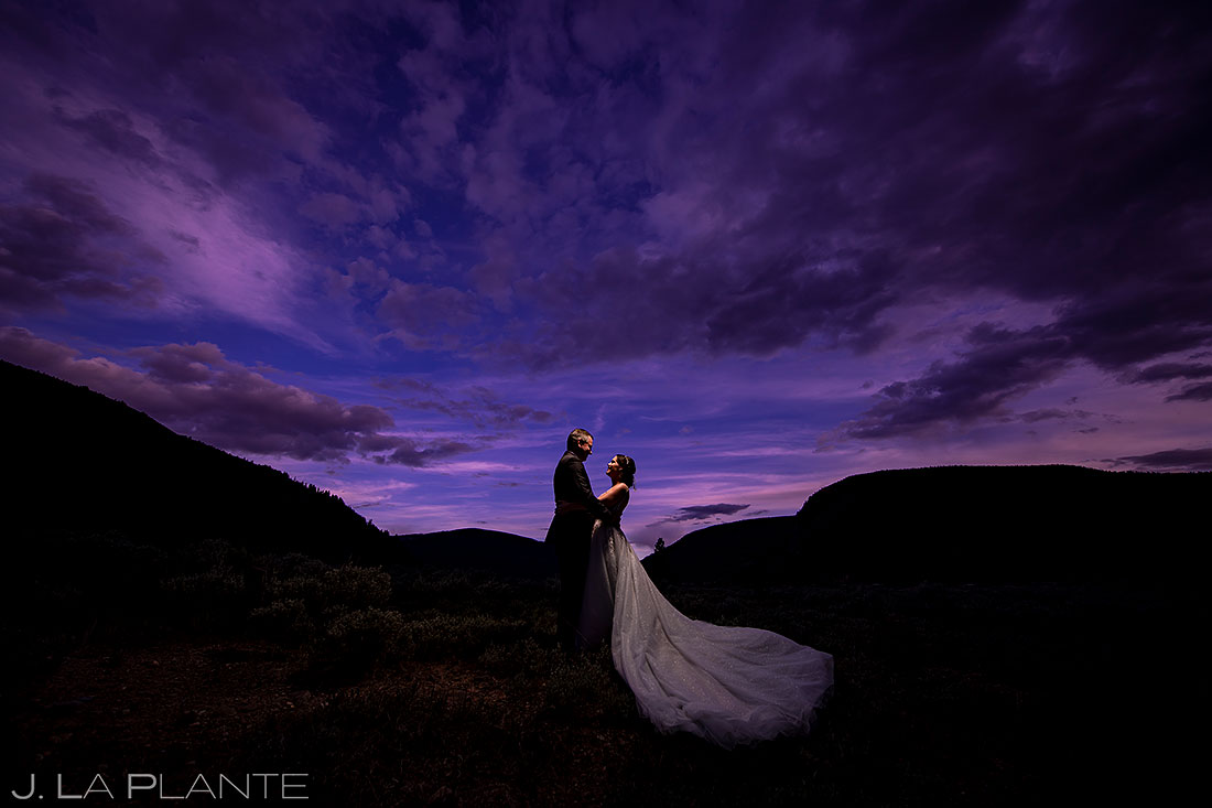 bride and groom portrait | colorful colorado sunset wedding