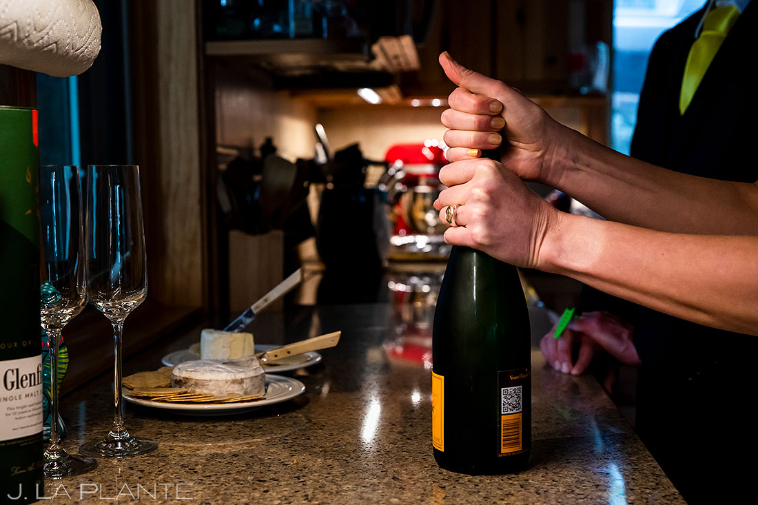 popping champagne to celebrate colorado elopement