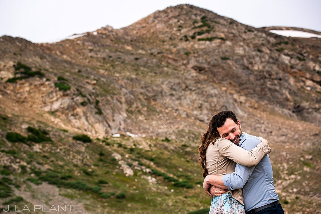 bride and groom to be hugging during loveland pass engagement session