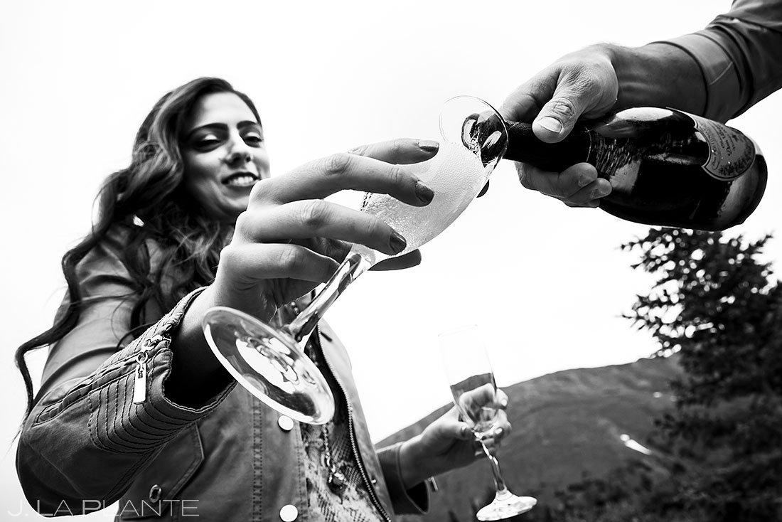 bride drinking a glass of Dom Pérignon