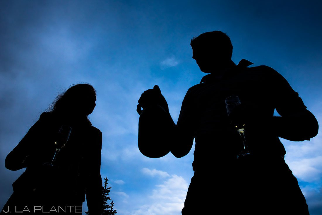 loveland pass engagement session bride and groom silhouettes