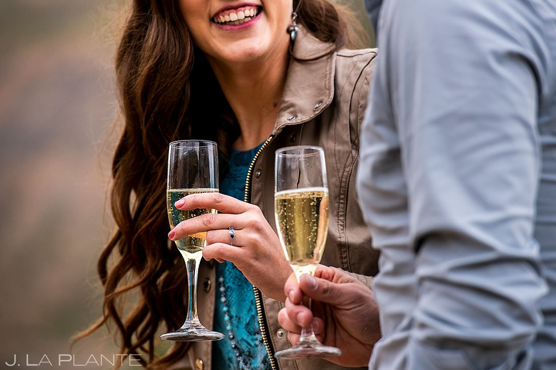 colorado engagement detail photos of ring and champagne