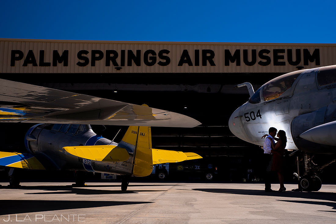bride and groom to be at the palm springs air museum hanger