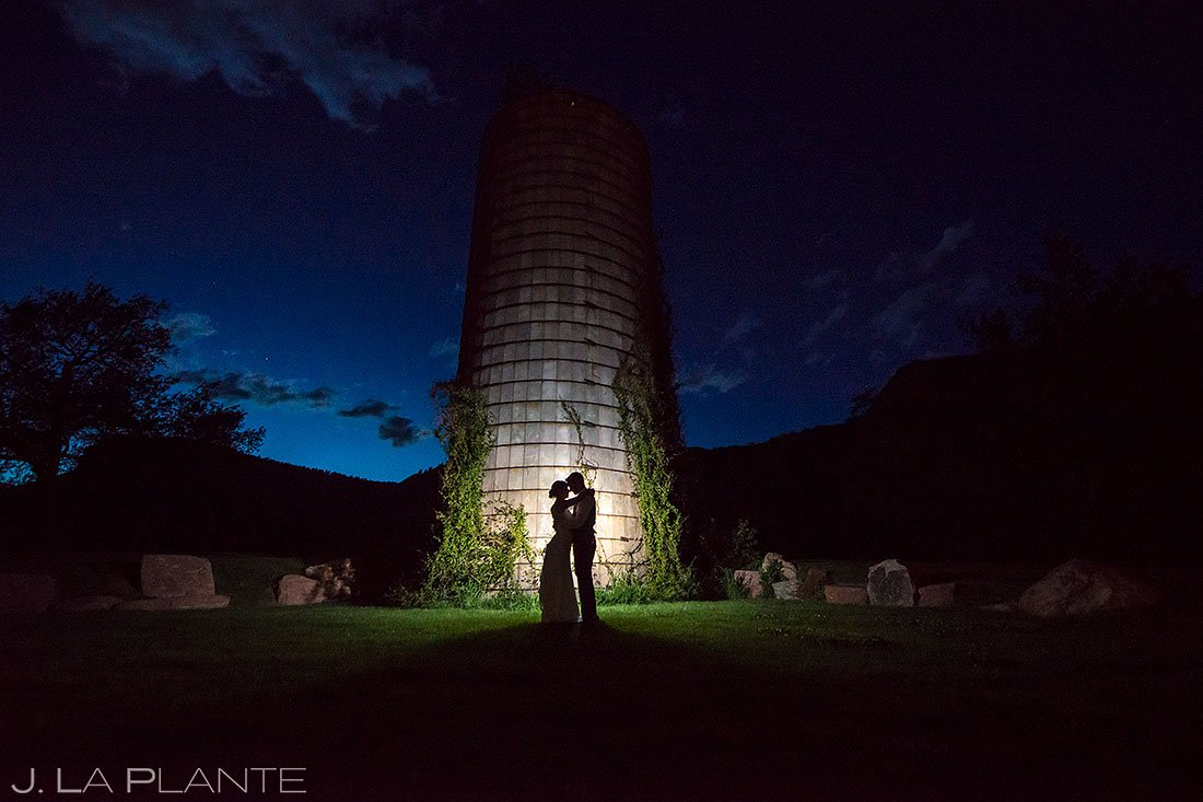 blue hour wedding photo of bride and groom by silo