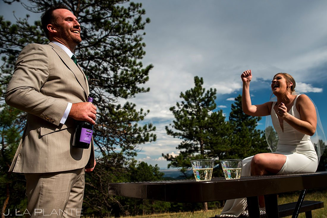 bride and groom drinking champagne during denver micro wedding