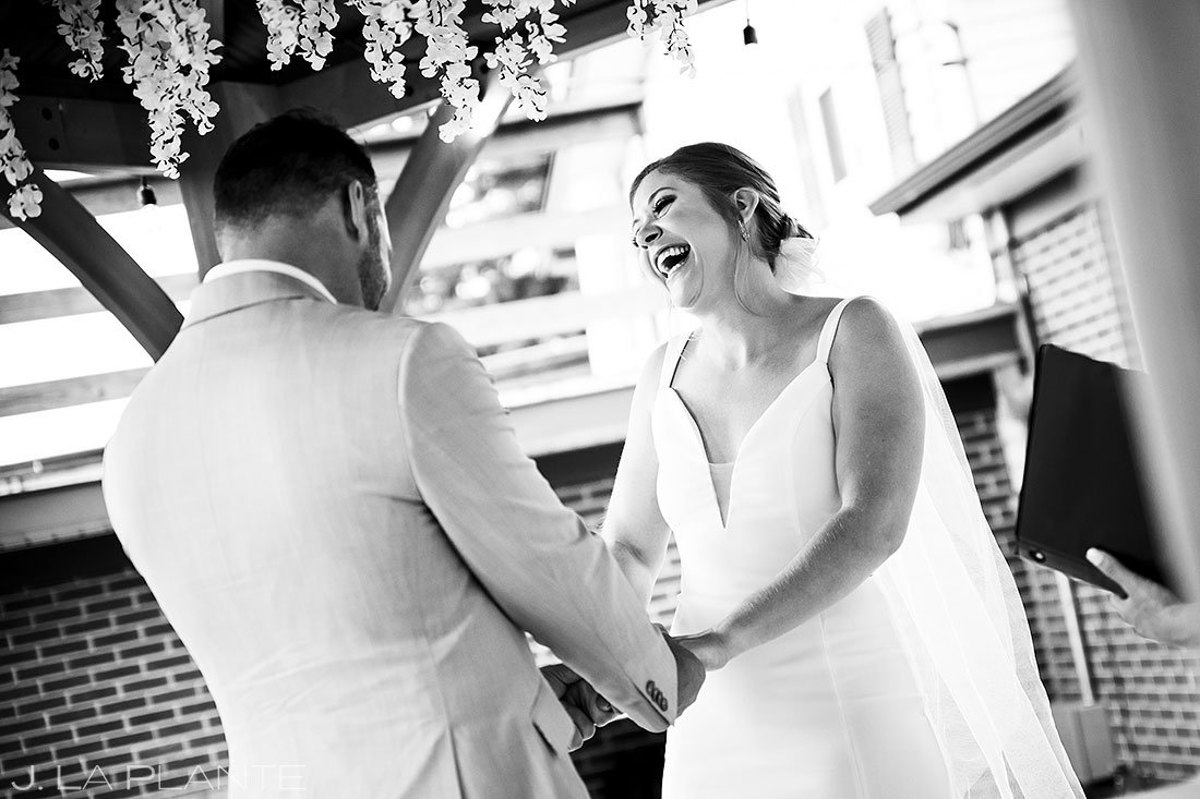 bride laughing during denver micro wedding ceremony
