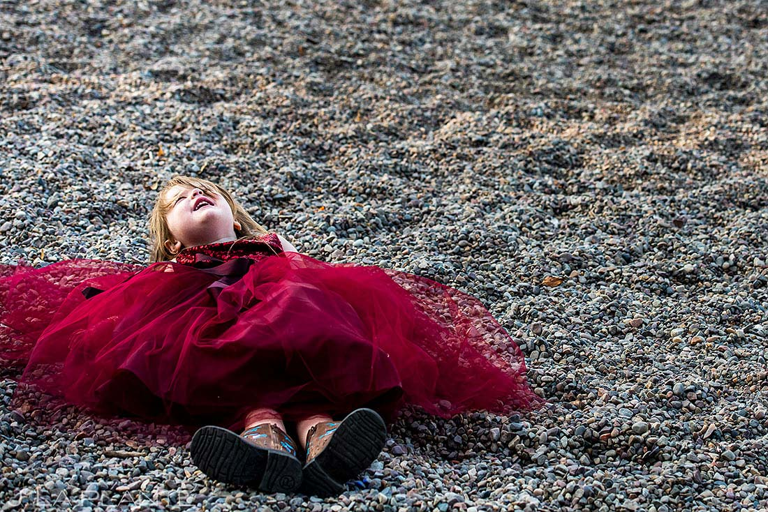 flower girl playing on the beach during wedding reception