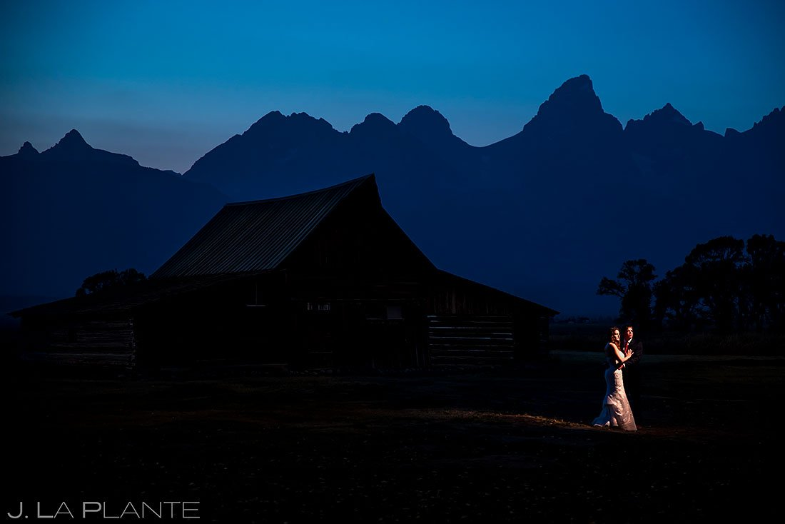 bride and groom at barn in jackson hole