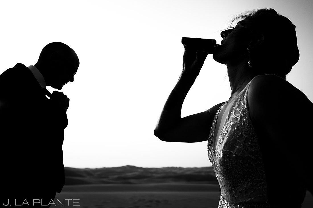 bride drinking whiskey before post wedding photoshoot