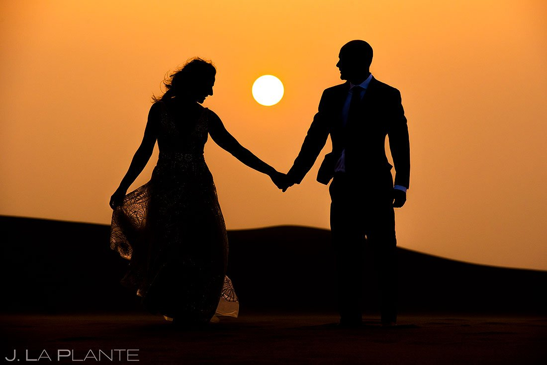 sunset portrait of bride and groom at the great sand dunes