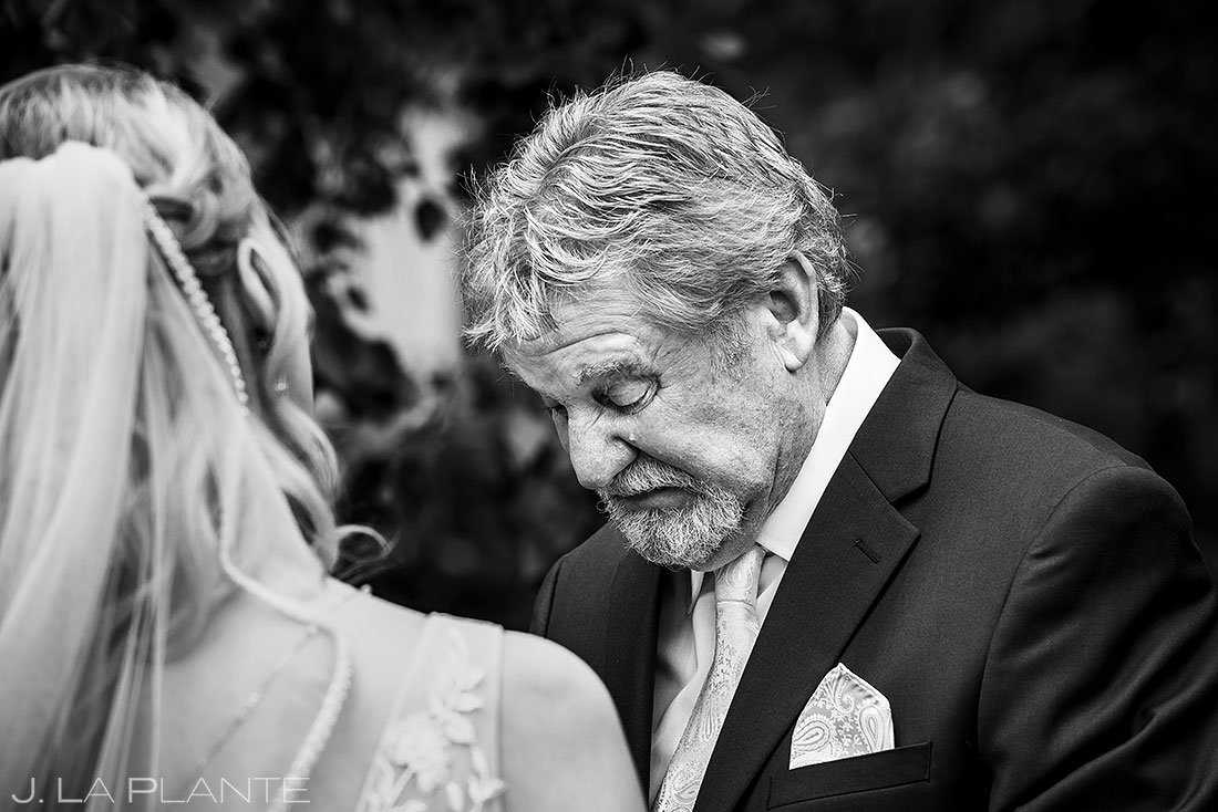father of the bride crying during first look with his daughter