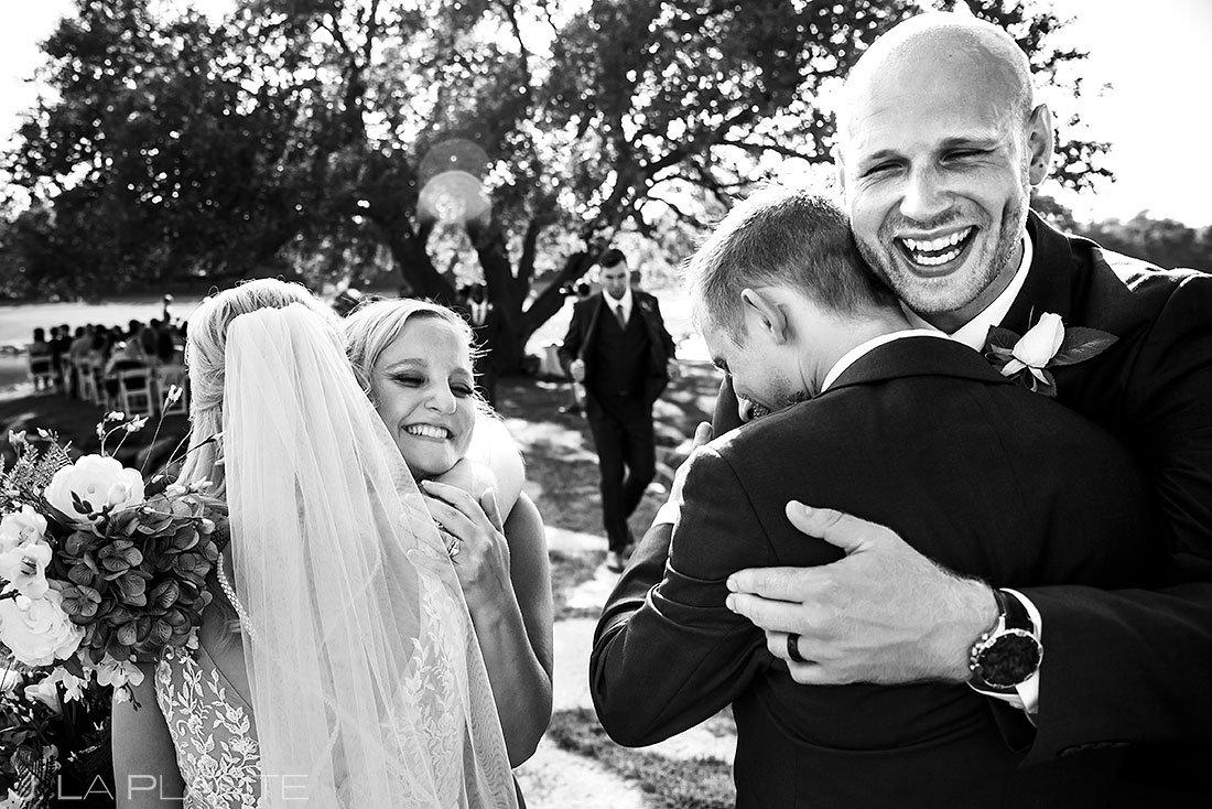 bride hugging her sister during pandemic wedding