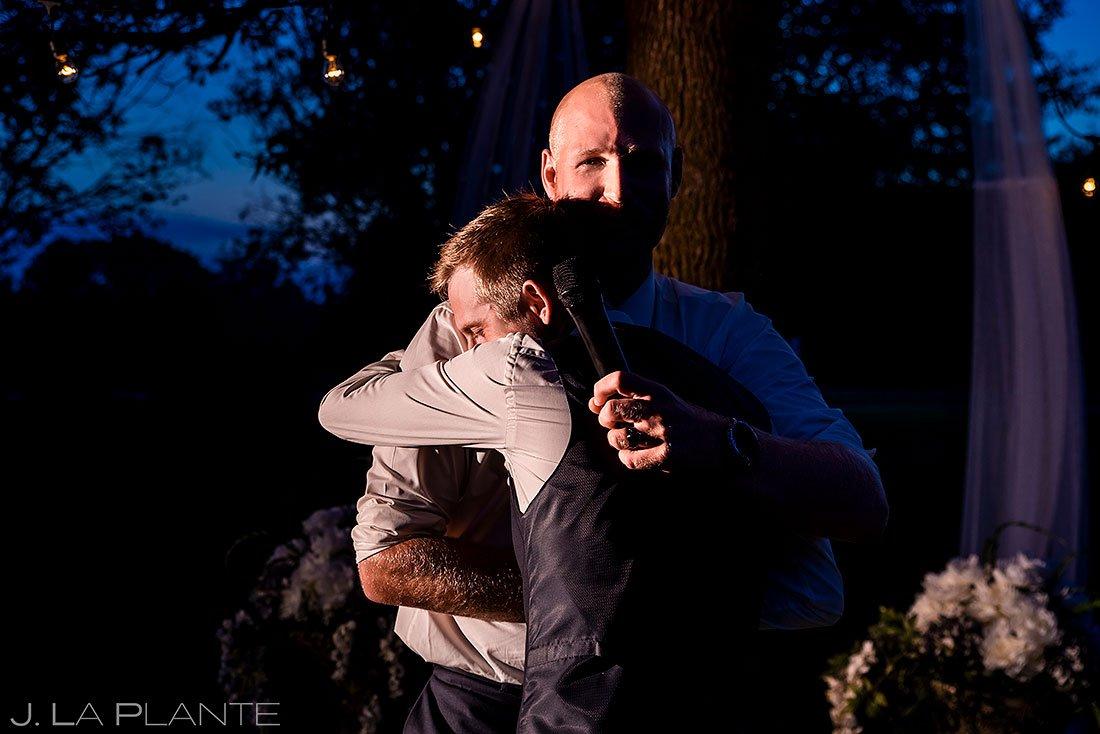 groom hugging best man during pandemic wedding