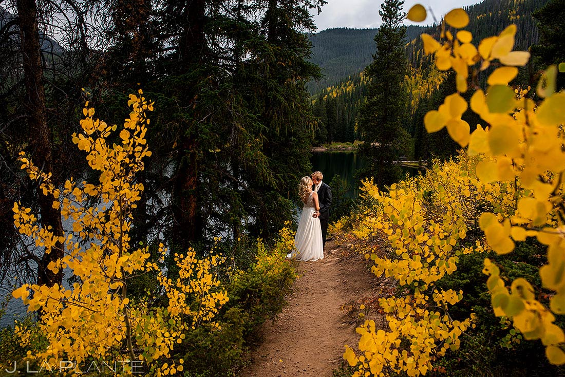 fall wedding near vail bride and groom with aspen trees