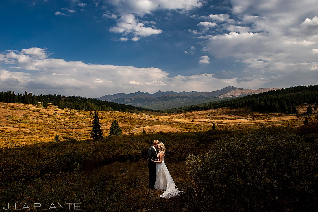 bride and groom hiking at shrine pass during pandemic wedding