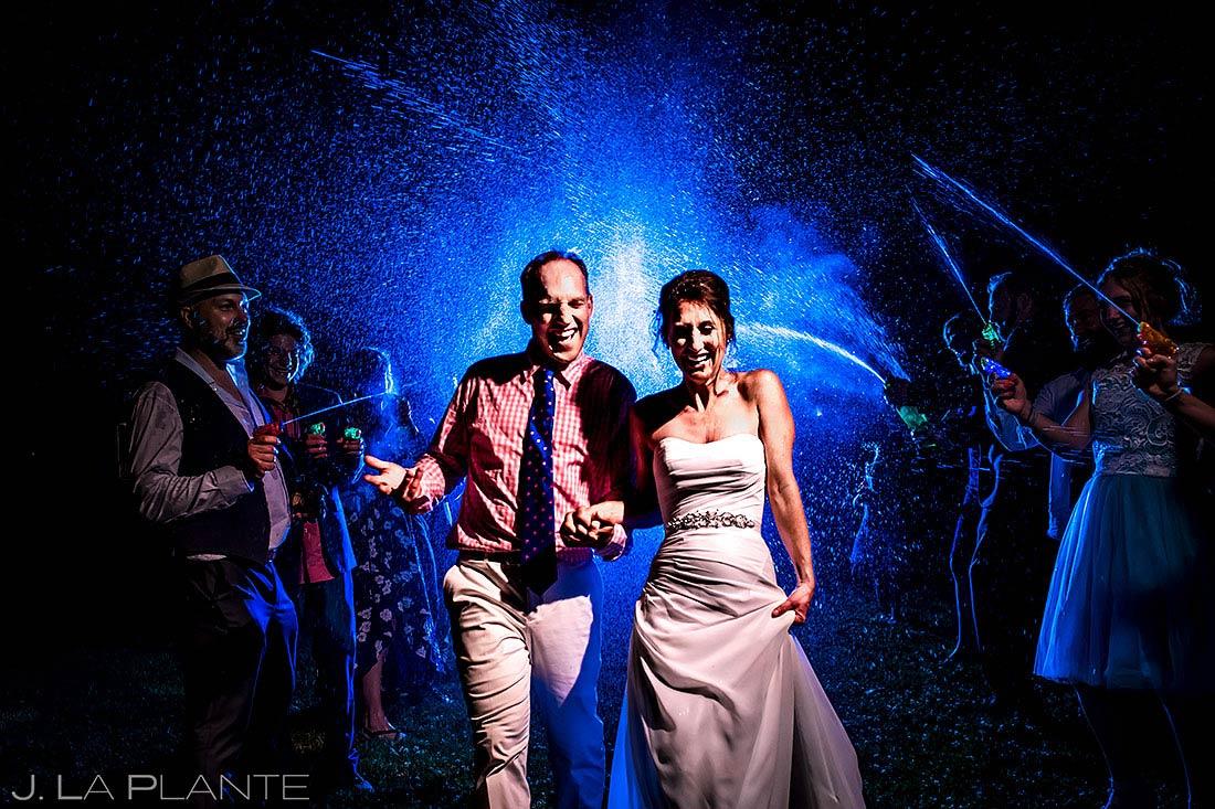 unique wedding send off ideas bride and groom squirt gun exit